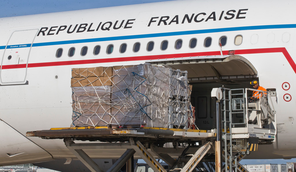 . Relief supplies are loaded to a French army plane to help the local population of the French Caribbean islands at Paris Charles de Gaulle airport in Roissy, France, Tuesday, Sept. 19, 2017. About 25,000 households lost electricity and two small towns are without potable water after Hurricane Maria roared past the French island of Martinique, damage considered minimal. (AP Photo/Michel Euler)