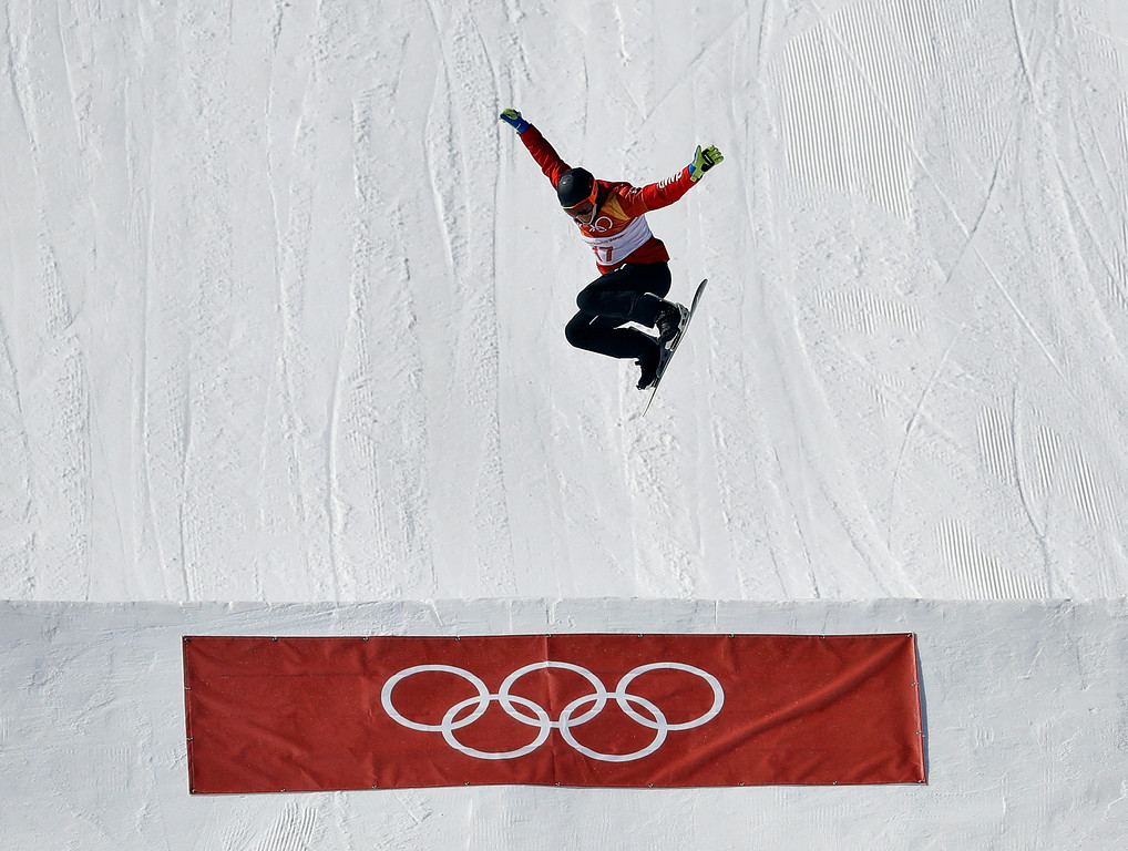 . Kevin Hill, of Canada, jumps during the men\'s snowboard cross seeding at Phoenix Snow Park at the 2018 Winter Olympics in Pyeongchang, South Korea, Thursday, Feb. 15, 2018. (AP Photo/Lee Jin-man)