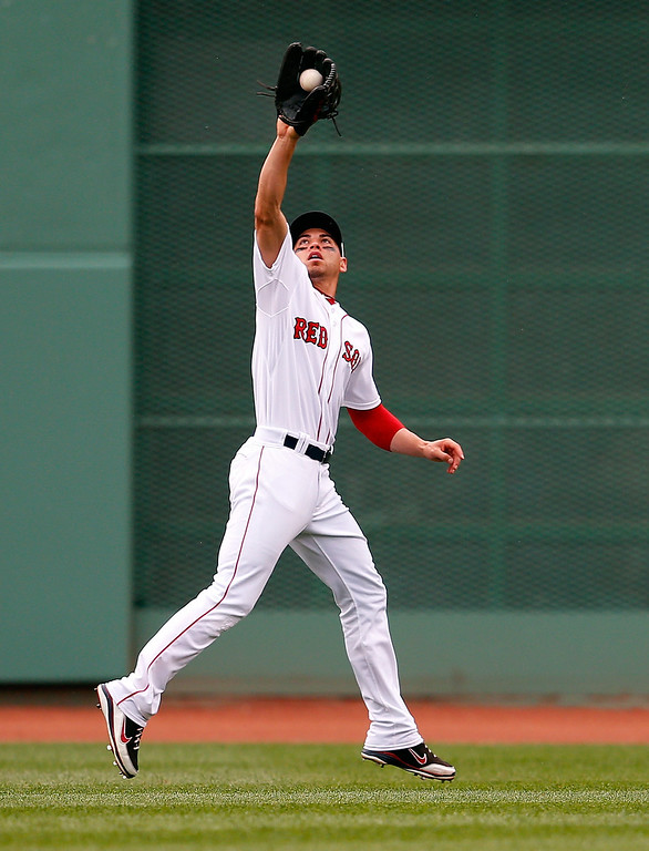 . Jacoby Ellsbury #2 of the Boston Red Sox makes a leaping catch against the Colorado Rockies in the 6th inning at Fenway Park on June 26, 2013 in Boston, Massachusetts.  (Photo by Jim Rogash/Getty Images)