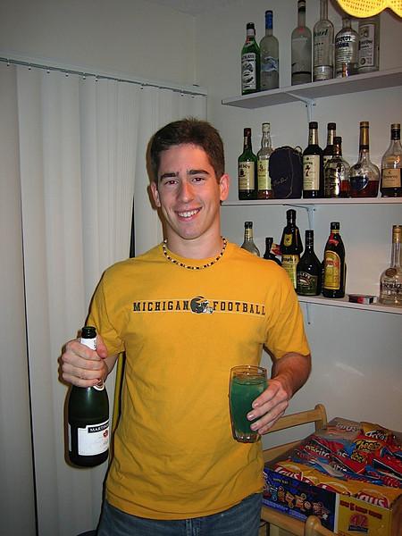 27 - Andrew drinking by himself on NYE.JPG