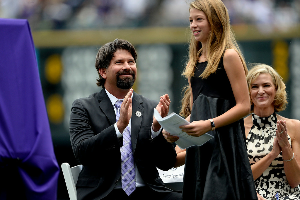 . Colorado Rockies great Todd Helton claps as his daughter, Tierney Faith, prepares to make a speech honoring her father during a retirement ceremony for his number 17. Helton, who played 17 season with the Rockies and holds records for many of the organizations career statistics, was honored on Sunday, August 17, 2014. (Photo by AAron Ontiveroz/The Denver Post)