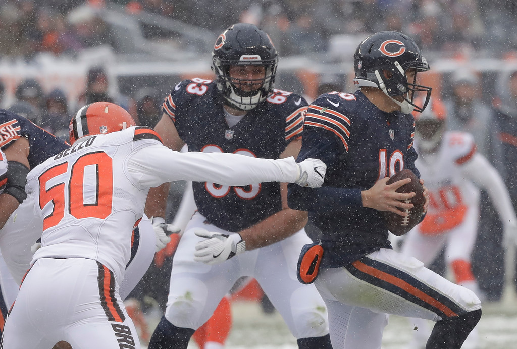 . Chicago Bears quarterback Mitchell Trubisky (10) escapes Cleveland Browns linebacker B.J. Bello (50) in the first half of an NFL football game in Chicago, Sunday, Dec. 24, 2017. (AP Photo/Charles Rex Arbogast)