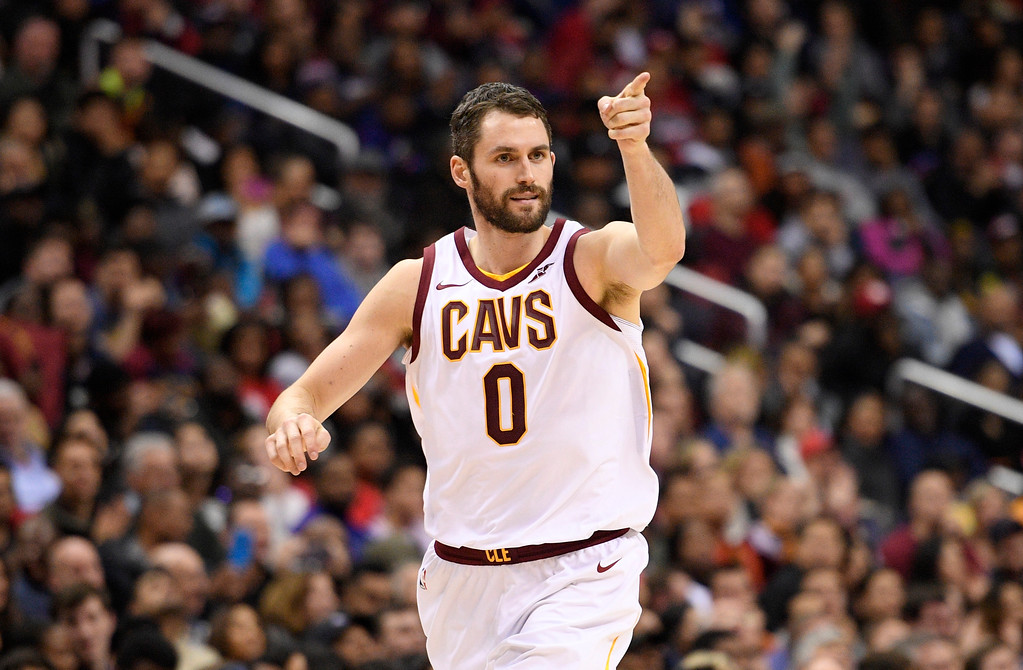 . Cleveland Cavaliers forward Kevin Love (0) points after he scored during the second half of an NBA basketball game against the Washington Wizards, Sunday, Dec. 17, 2017, in Washington. The Cavaliers won 106-99. (AP Photo/Nick Wass)