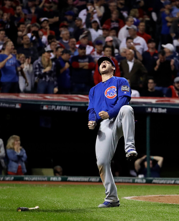 . Chicago Cubs\' Anthony Rizzo reacts after scoring on a hit by Miguel Montero during the 10th inning of Game 7 of the Major League Baseball World Series against the Cleveland Indians Wednesday, Nov. 2, 2016, in Cleveland. (AP Photo/David J. Phillip)