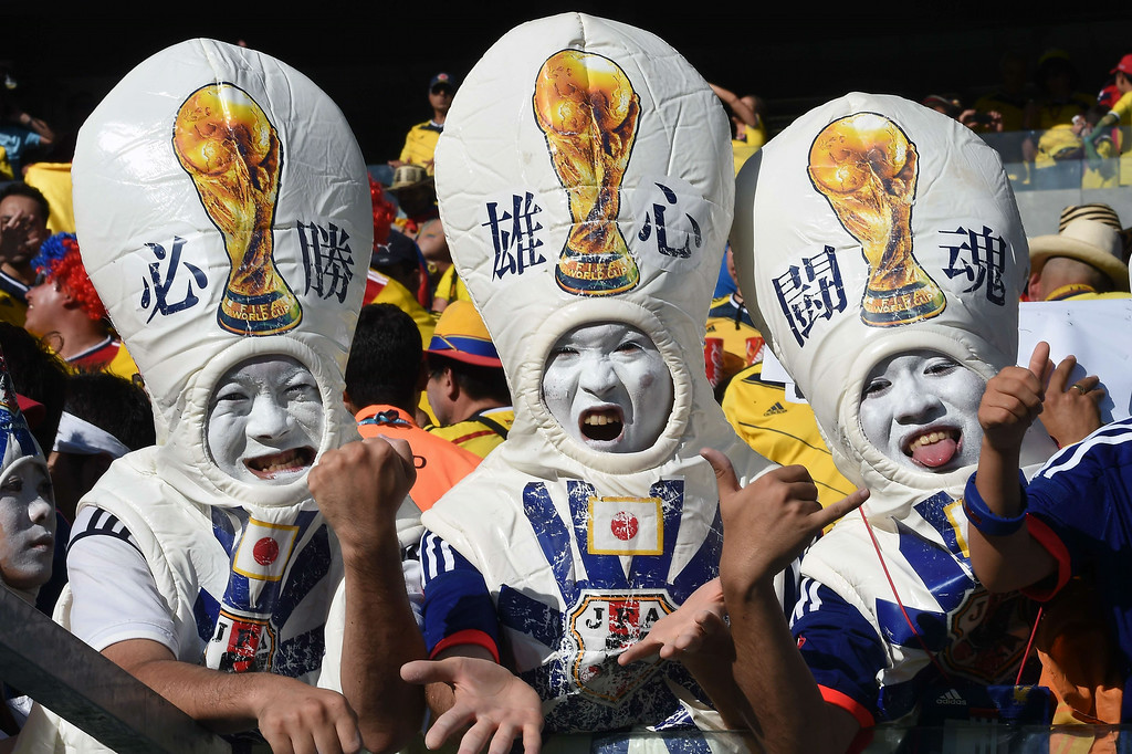 . Japan\'s fans cheer prior to the start of a Group C football match between Japan and Colombia at the Pantanal Arena in Cuiaba during the 2014 FIFA World Cup on June 24, 2014.     LUIS ACOSTA/AFP/Getty Images