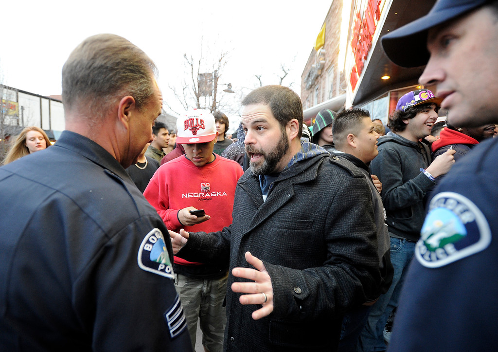 . An unidentified man who allegedly works at The Fox Theater talks with police during a disturbance on Monday, March 11, in Boulder. Boulder Police responded with riot gear to keep the fans of the band Tyler the Creator under control.  Jeremy Papasso/Boulder Daily Camera