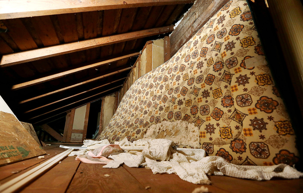 . In this photo taken Monday, Sept. 23, 2013, a mattress used in childhood by Kurt Cobain, the late frontman of Nirvana, leans on the wall in an attic crawlspace of his family home in Aberdeen, Wash. (AP Photo/Elaine Thompson)