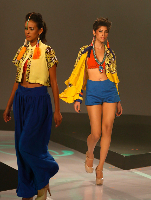 . In this Wednesday, April 3, 2013 photo, Sri Lankan models present creations by Charini Suriyage during Colombo Fashion Week in Colombo, Sri Lanka. (AP Photo/Eranga Jayawardena)