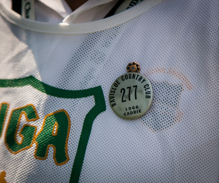 John Vitt who is caddying for his son Andrew wears his Ravisloe CC caddy pin from 1966 during the second round medal play at the 2012 Western Amateur Championship at Exmoor Country Club in Highland Park IL. on Wednesday, August 1, 2012. (WGA Photo/Charles Cherney)