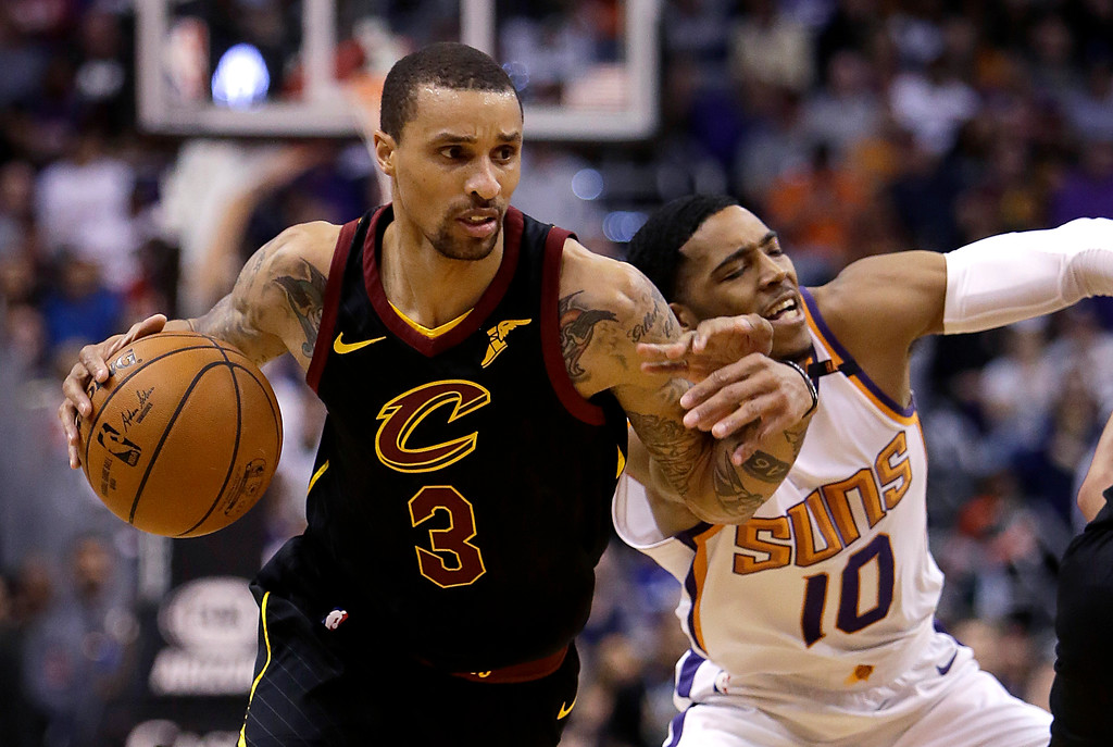 . Cleveland Cavaliers guard George Hill (3) drives on Phoenix Suns guard Shaquille Harrison in the first half during an NBA basketball game, Tuesday, March 13, 2018, in Phoenix. (AP Photo/Rick Scuteri)
