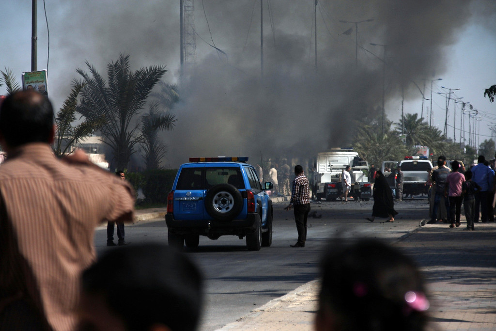 . Smoke rises from the site of a bomb attack in Baghdad\'s Sadr City March 19, 2013. A dozen car bombs and suicide blasts tore into Shi\'ite districts in Baghdad and south of the Iraqi capital on Tuesday, killing more than 50 people on the 10th anniversary of the U.S.-led invasion that ousted Saddam Hussein. REUTERS/Wissm al-Okili
