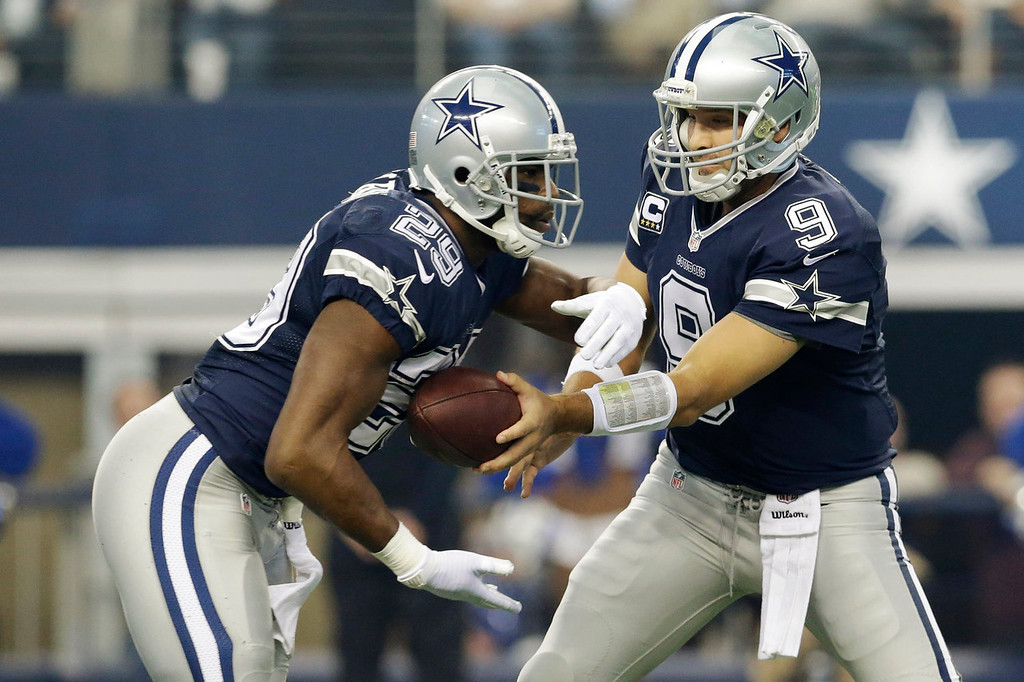 . Dallas Cowboys quarterback Tony Romo (9) hands the ball to DeMarco Murray (29) during the first half of an NFL football game against the Oakland Raiders, Thursday, Nov. 28, 2013, in Arlington, Texas.  (AP Photo/LM Otero)