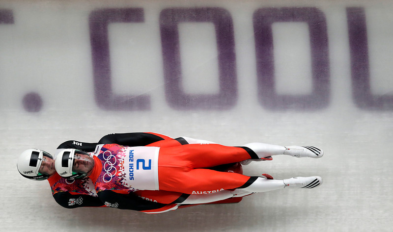 . The doubles team of Andreas Linger and Wolfgang Linger of Austria speed down the track in their final run during the men\'s doubles luge at the 2014 Winter Olympics, Wednesday, Feb. 12, 2014, in Krasnaya Polyana, Russia. The team won the silver medal. (AP Photo/Michael Sohn)