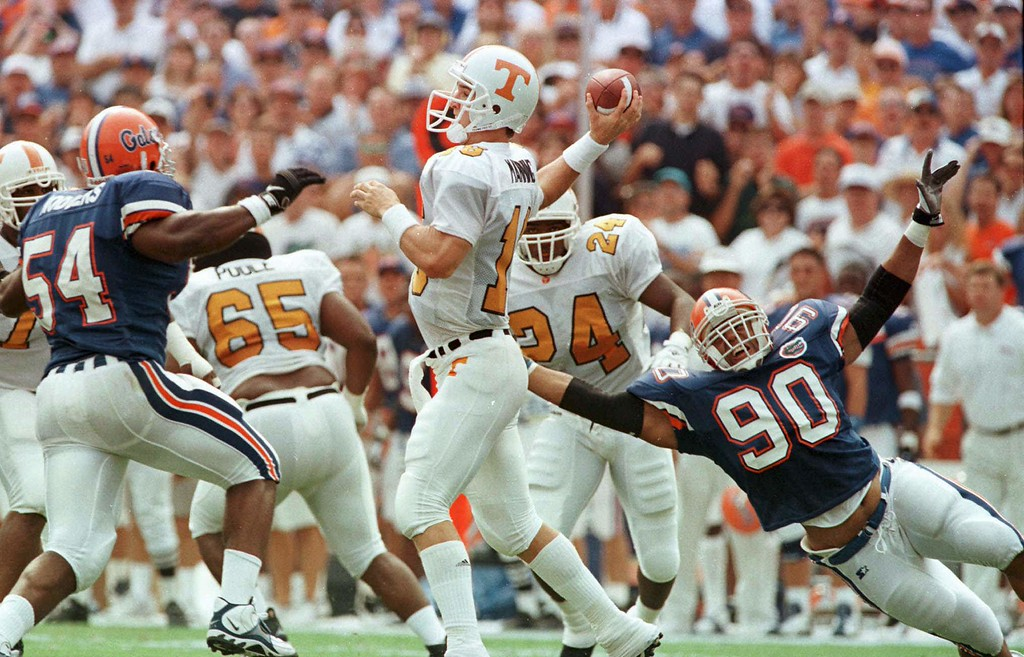 . Tennessee quarterback Peyton Manning (16) is rushed by Florida\'s Willie Rogers (54) and Mike Motem (90) during their game Saturday, Sept. 20, 1997 in Gainesville, Fla. (AP Photo/Florida Times-Union, Bob Self)