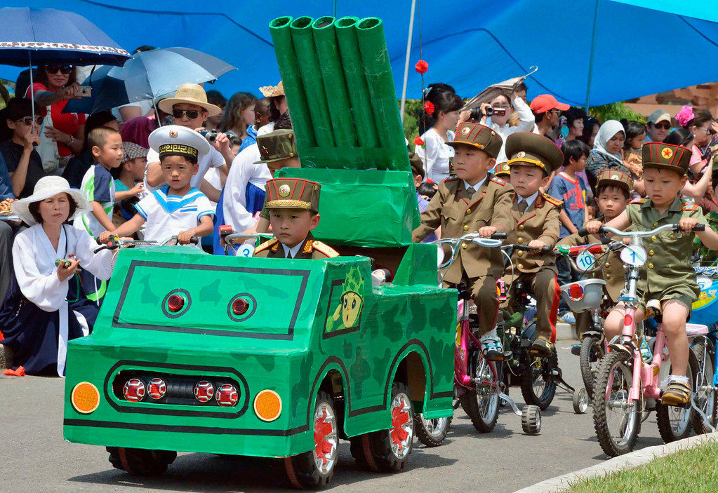 . Children take part in a mock military parade at an amusement park in Pyongyang to mark International Children\'s Day, in this photo taken by Kyodo June 1, 2013.    Mandatory Credit.  REUTERS/Kyodo