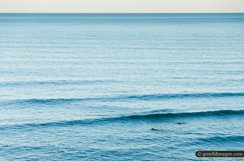 Two surfers take it easy of the coast of Flinders on a pristine mid-Winter's day.