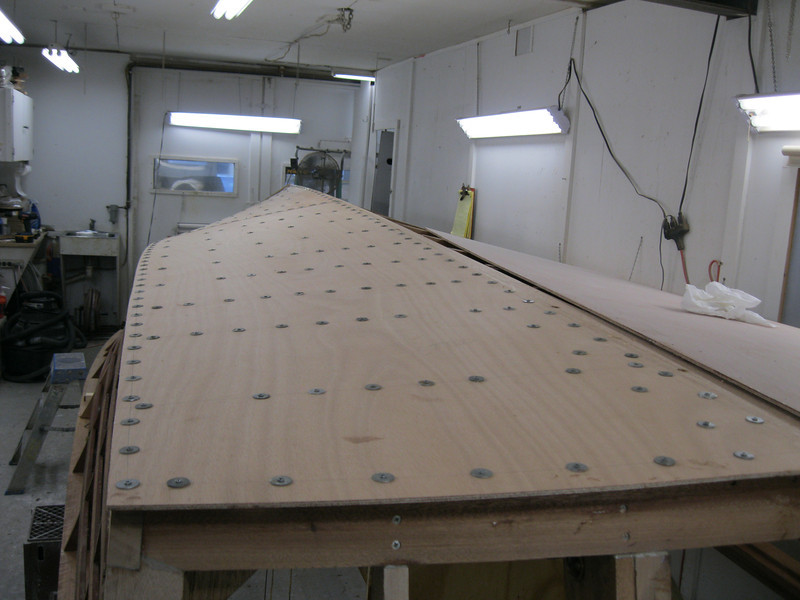 Rear starboard view of first bottom layer glued and held in place with temporary fasteners.