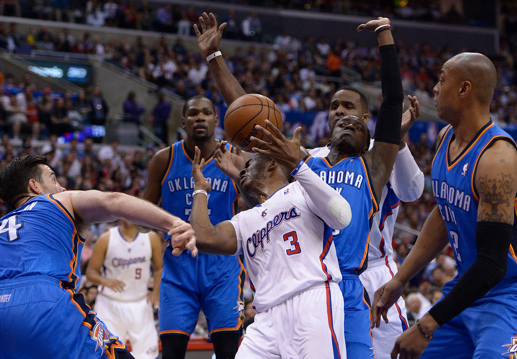 . Clippers#3 Chris Paul is contested by a host of Thunder players in the first half. The Los Angeles Clippers played the Oklahoma City Thunder in a regular season game at Staples Center in Los Angeles, CA. 4/9/2014(Photo by John McCoy / Los Angeles Daily News)