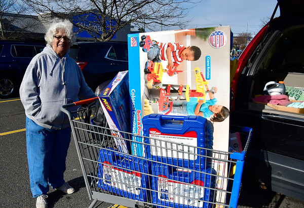 11/29/2019 Mike Orazzi | Staff Dolores Stockmal after shopping for Black Friday deals at the Walmart in Bristol on Friday.