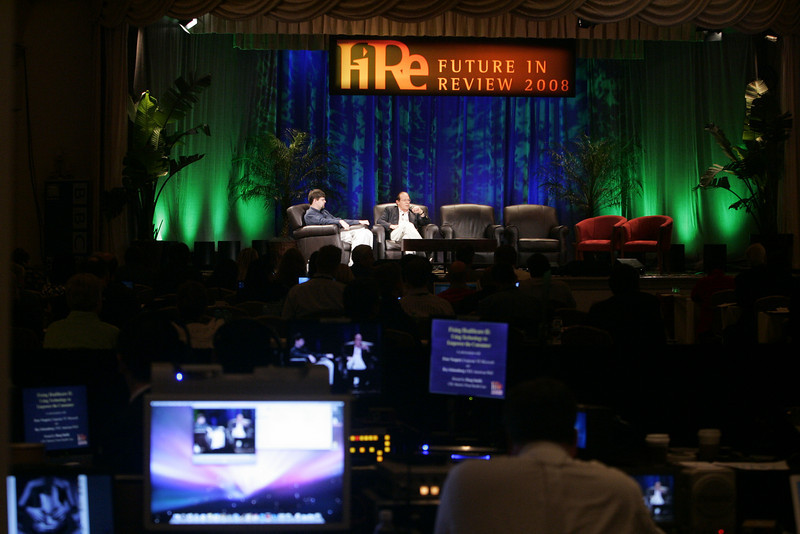 """""""Fixing Healthcare I: Bringing Third-World Costs to the U.S."""": Tom Krazit (L) of CNET Networks interviews Eric Haseltine, chair of Haseltine Global Health and founder, Human Genome Sciences"""