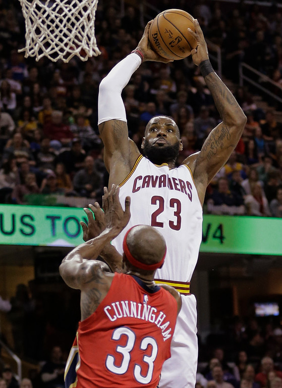 . Cleveland Cavaliers\' LeBron James (23) drives to the basket against New Orleans Pelicans\' Dante Cunningham (33) in the first half of an NBA basketball game, Monday, Jan. 2, 2017, in Cleveland. (AP Photo/Tony Dejak)