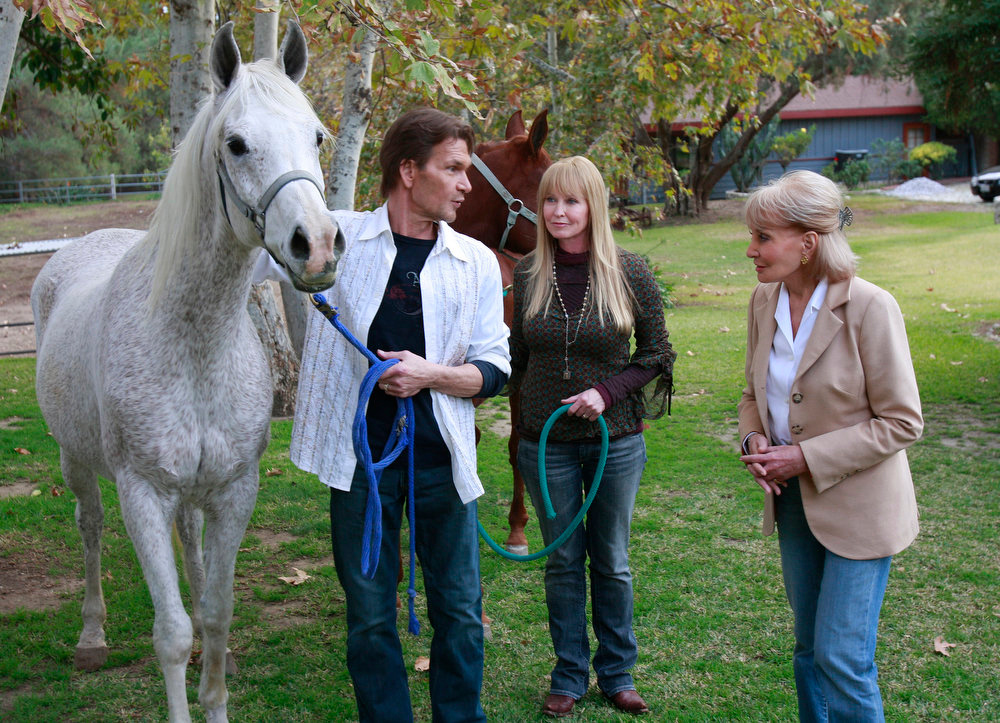 """. Barbara Walters, right, visits with actor Patrick Swayze, left, and his wife Lisa Niemi at their California ranch on Dec. 6, 2008.  In his first television interview since being diagnosed with pancreatic cancer, Swayze speaks to Barbara Walters in  \""""Barbara Walters Special-Patrick Swayze: The Truth\"""".   (AP Photo/ABC, Ron Tom)"""