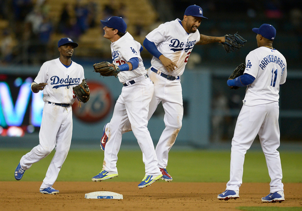 . Dee Gordon, Miguel Rojas, Matt Kemp and Erisbel Arruebarrena celebrate the win. The Dodgers defeated the San Diego Padres 8-6 at Dodger Stadium. Los Angeles, CA. 8/19/2014(Photo by John McCoy Daily News)