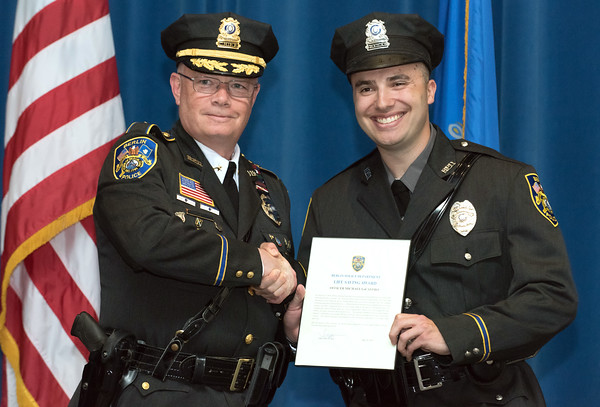 05/15/18 Wesley Bunnell | Staff Berlin Police held their 2018 Awards Ceremony on Tuesday May 15th at Eversource Energy at 107 Selden St. Police Chief John Klett, L, presents Officer Michael LoCastro with a Lifesaving Award for his help in saving a a citizen , Louis Rivera.