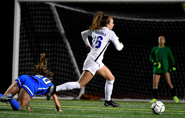 11/23/2019 Mike Orazzi | Staff Glastonbury High School's Caroline Kearns (26) and Southington High School's Katherine Crouse (20) during the Class LL Girls State Soccer Tournament at Veterans Stadium in New Britain Saturday evening. Glastonbury defeated Southington 1-0.