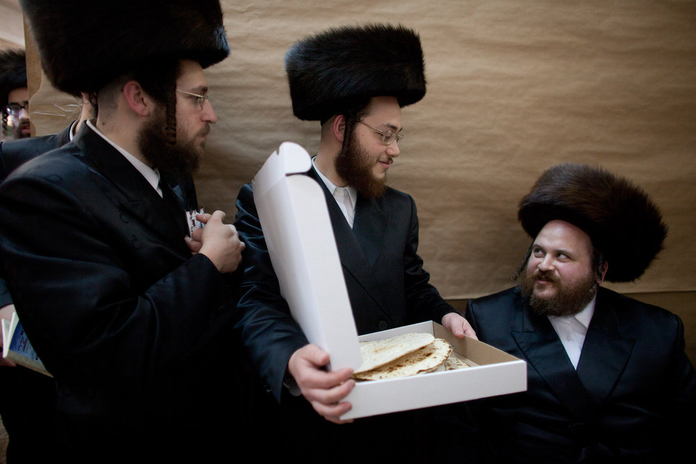 . Ultra-Orthodox Jewish men inspect their  Matzoth, or unleavened bread, in a final preparation before the start at sundown of the Jewish Pesach (Passover) holiday on March 25, 2013 in Bnei Brak, Israel. Religious Jews throughout the world eat matzoth during the eight-day Passover, or Pesach, holiday, The Jewish holiday commemorates the Israelis\' exodus from Egypt some 3,500 years ago and their ancestors\' plight by refraining from eating leavened food. Passover begins March 25 and ends on the evening of April 02.  (Photo by Uriel Sinai/Getty Images)