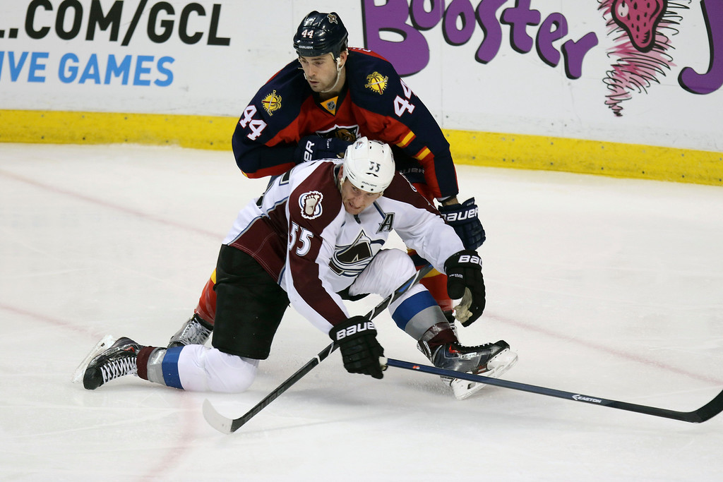 . Florida Panthers\' Erik Gudbranson (44) and Colorado Avalanche\' Cody McLeod (55) battle for the puck during the third period of an NHL hockey game, Thursday, Jan. 15, 2015 in Sunrise, Fla. The Avalanche won 4-2. (AP Photo/J Pat Carter)