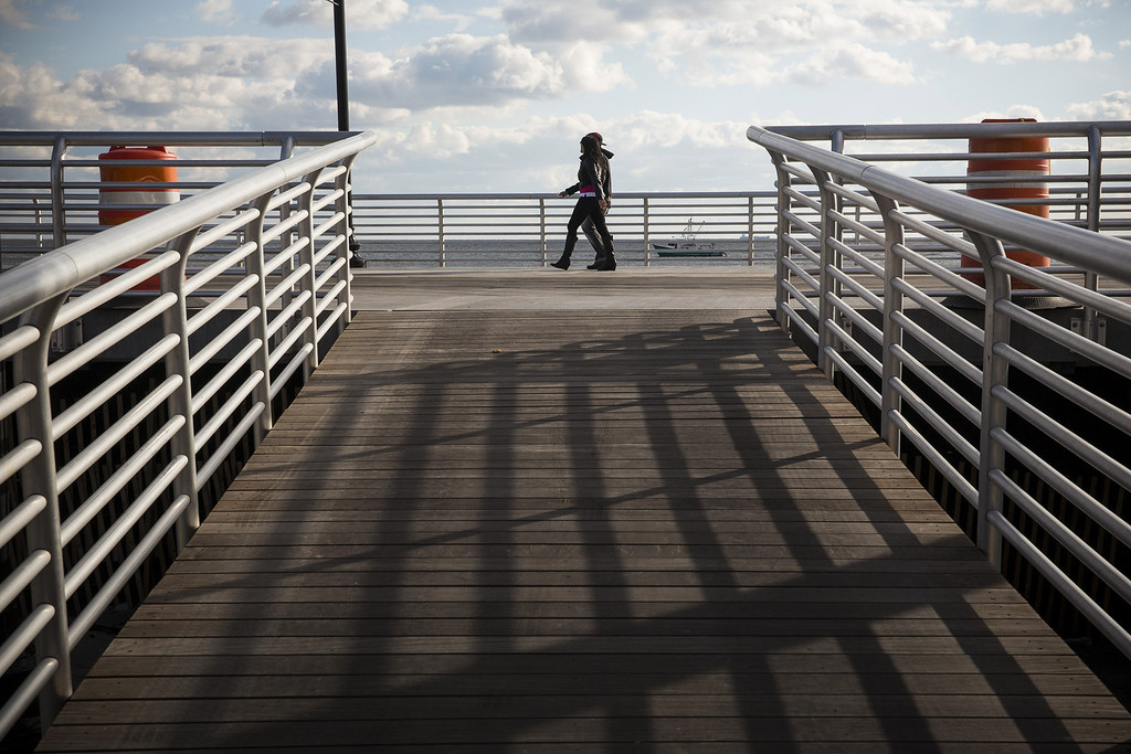 . LONG BEACH, NY - OCTOBER 25:  A couple walks along the newly reopened boardwalk on October 25, 2013 in Long Beach, New York. The boardwalk was severely damaged by Superstorm Sandy last year, which killed 285 people and caused billions of dollars in damage. Long Beach\'s new boardwalk is made of Brazilian hardwood and is estimated to have a lifespan of 30-40 year; the previous boardwalk was only scheduled to last  three to seven years. (Photo by Andrew Burton/Getty Images)