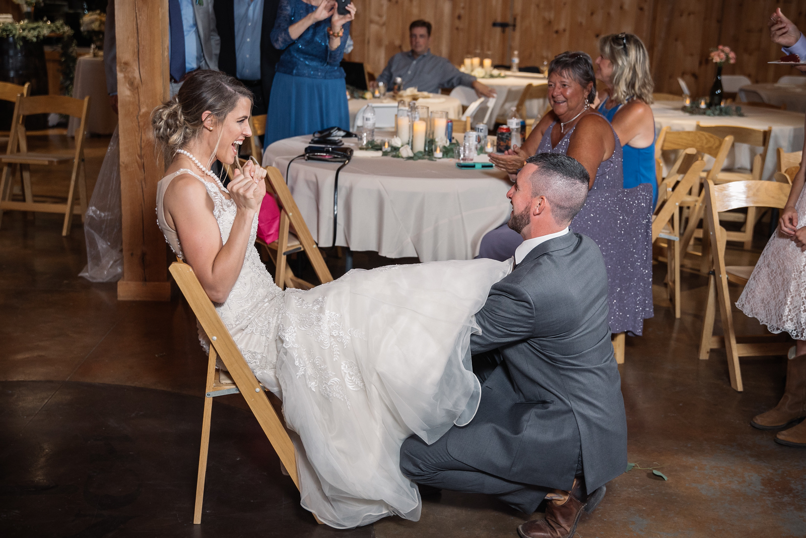 a groom removing his wifes garter