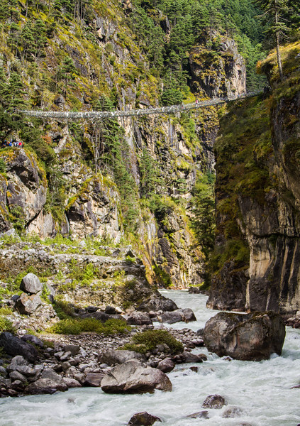 View of rope bridge over river - Nepal