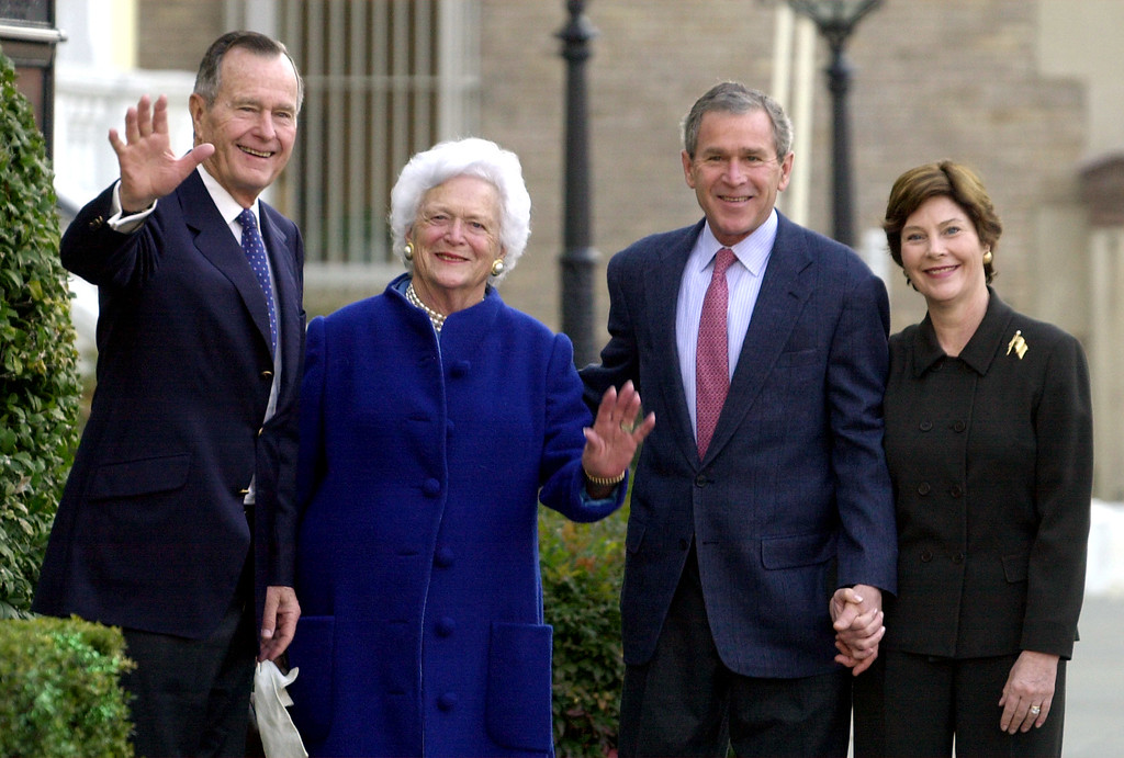 . President Bush, second right, and first lady Laura Bush, right, leave Saint John\'s Church in Washington, Sunday, Jan 27, 2002, with former President George H. W. Bush and former first lady Barbara Bush after attending Sunday service. President Bush will deliver his first State of the Union address on Tuesday. (AP Photo/Susan Walsh)