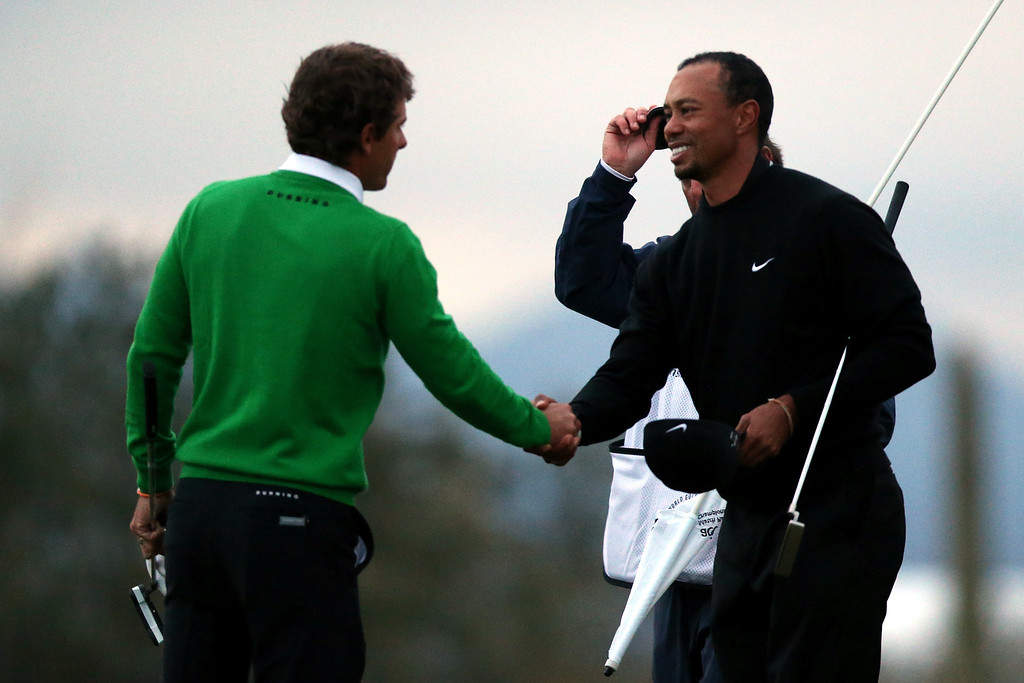 . MARANA, AZ - FEBRUARY 21:  (L-R) Charles Howell III is congratulaed by Tiger Woods after Howell won their match 2 and 1 in 17 holes during the first round of the World Golf Championships - Accenture Match Play at the Golf Club at Dove Mountain on February 21, 2013 in Marana, Arizona. Round one play was suspended on February 20 due to inclimate weather and is scheduled to be continued today.  (Photo by Jed Jacobsohn/Getty Images)