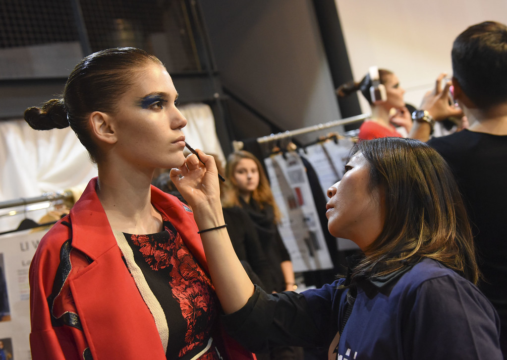 . NEW YORK, NY - FEBRUARY 15:  A model prepares backstage at the Tracy Reese show during Mercedes-Benz Fashion Week Fall 2015 at ArtBeam on February 15, 2015 in New York City.  (Photo by Vivien Killilea/Getty Images)
