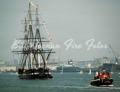 "USS Constitution in the harbor..the ""FIREFIGHTER"" is in front"