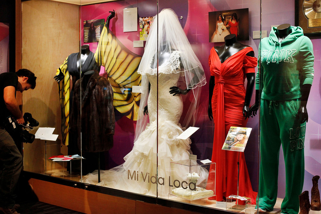 ". Mexican-American singer Jenni Rivera\'s costumes and memorabilia are displayed in a new exhibit: ""Jenni Rivera, La Gran Senora,\"" at the Grammy Museum at L.A. Live in Los Angeles on Friday, May 10, 2013. The exhibit opened on Mother\'s Day, May 12, shows Rivera as the \""Diva of Banda,\"" due to her work within the banda and nortena music genres. Rivera, along with six others, died in a plane crash in Mexico, on Dec. 9, 2012.  (AP Photo/Nick Ut)"