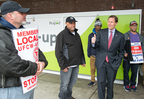 04/15/19 Wesley Bunnell | Staff Senator Richard Blumenthal visited area Stop & Shop Supermarkets on Monday afternoon speaking to striking workers on the importance of not just protecting their jobs but helping to uphold other jobs in the middle class. Meat Department Manager Glenn Rosa,L, receives a thumbs up from Senator Blumenthal.