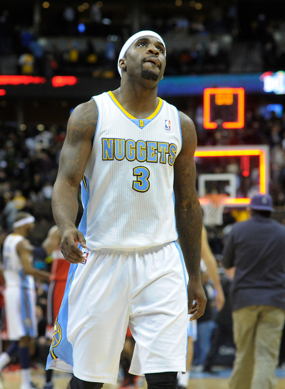 . DENVER, CO - JANUARY 18: Ty Lawson showed his disappointment at the end of the game. The Washington Wizards defeated the Denver Nuggets 112-108 at the Pepsi Center Friday night, January 18, 2013. Karl Gehring/The Denver Post