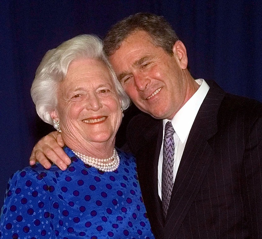 . Texas Gov. George W. Bush, right, gives his mother, Barbara Bush , a hug after taking a family photo Thursday, June 10, 1999 in Houston. The Bush family gathered to celebrate former president George Bush and Barbara\'s birthdays. George Bush will turn 75 Saturday and Barbara turned 74 Tuesday. (AP Photo/David J. Phillip)