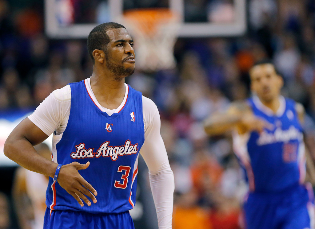 . Los Angeles Clippers guard Chris Paul (3) reacts to a made shot against the Phoenix Suns during the second half of an NBA basketball game, Wednesday, April 2, 2014,in Phoenix. The Clippers won 112-108. (AP Photo/Matt York)