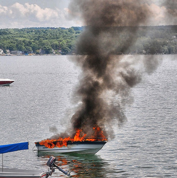 Jack Haley/Messenger Post MediaA boat is destroyed by flames on the west shore of Canandaigua Lake. Cheshire firefighters set up their truck on County Road 16 at Wyffls road and the patrol boat of the Ontario County Sheriff's office transported the hose and firefighters to extinguish the blaze.