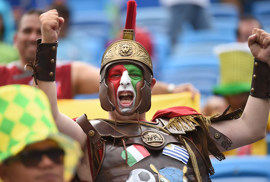 . Italy fans cheer their team prior to the Group D football match between Italy and Uruguay at the Dunas Arena in Natal during the 2014 FIFA World Cup on June 24, 2014.  AFP PHOTO / EMMANUEL DUNAND/AFP/Getty Images