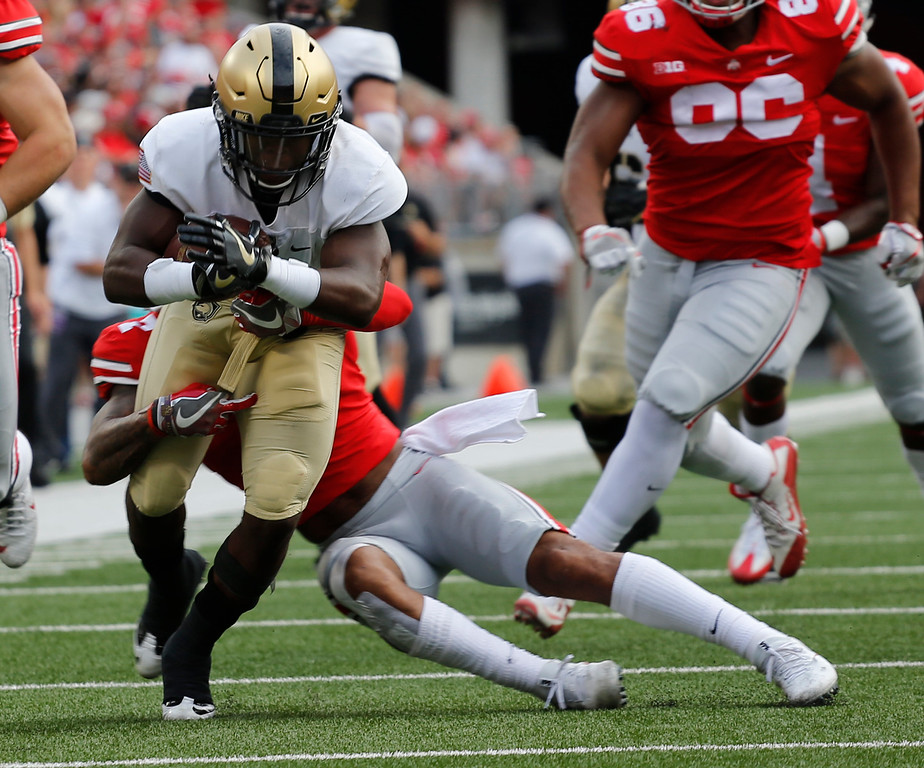 . Army running back Kell Walker, left, is tackled by Ohio State safety Damon Webb during the first half of an NCAA college football game Saturday, Sept. 16, 2017, in Columbus, Ohio. (AP Photo/Jay LaPrete)