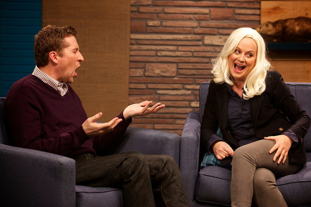 ". Host Scott Aukerman confronts guest Amy Poehler about her hair and feud with Mad Magazine in IFC\'s ""Comedy Bang! Bang!\""  (Photo by Chris Ragazzo/IFC)"