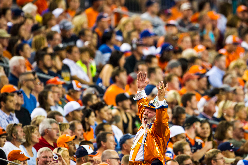 . Fans cheer during a preseason game between the Denver Broncos and the Seattle Seahawks at Sports Authority Field at Mile High on Thursday, August 07, 2014 in Denver, Colorado.  (Photo by Kent Nishimura/The Denver Post)