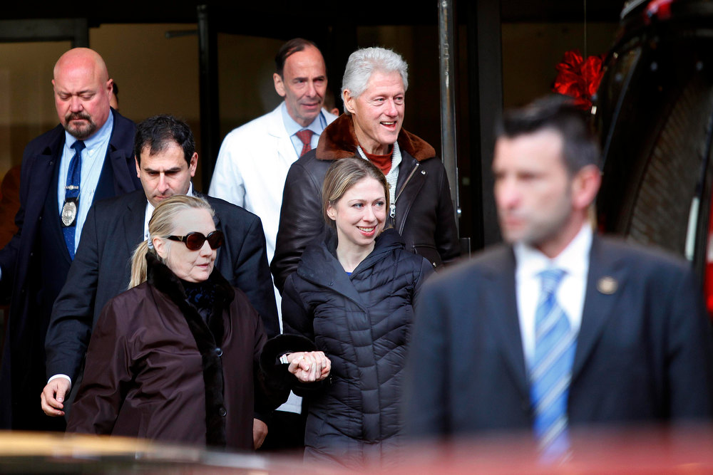 Description of . U.S. Secretary of State Hillary Clinton (L) leaves New York Presbyterian Hospital with husband, Bill (TOP), and daughter, Chelsea (C), in New York, January 2, 2013. The secretary of state, who has not been seen in public since Dec. 7, was revealed on Sunday evening to be in a New York hospital under treatment for a blood clot that stemmed from a concussion she suffered in mid-December. REUTERS/Joshua Lott