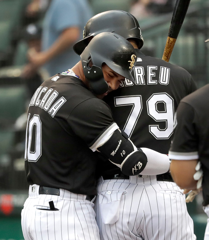 . Chicago White Sox\'s Yoan Moncada, left, hugs Jose Abreu after Moncada\'s home run off Cleveland Indians starting pitcher Adam Plutko during the first inning of a baseball game Tuesday, June 12, 2018, in Chicago. (AP Photo/Charles Rex Arbogast)